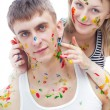 Guy and his girl friend painted with paints — Stock Photo