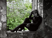 Woman in grunge style sitting on window with lil — Photo