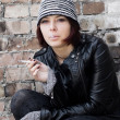 Photo of woman in grunge style smoking a cigarette — Stock Photo
