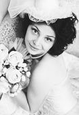 Black and white portrait of young brunette bride — Stock Photo