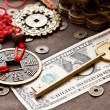 Key on dollar with feng shui symbol — Stock Photo #40196081