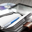 Pen, notebook, mobile phone, tablet and discs — Stock Photo #40196351