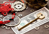 Key on dollar with feng shui symbol — Stock Photo