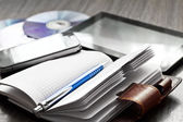 Pen, notebook, mobile phone, tablet and discs — Stock Photo