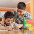 Stock Photo: Two little boys write homework