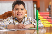 Schoolboy writing homework — Foto Stock