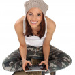 Young woman sitting on the floor and using a digital tablet — Stock Photo