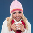 Beautiful young woman with winter cap and scarf around the neck — Stock Photo