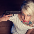Suicidal young womwith tears and gun pointed at head — Stock Photo #39471457