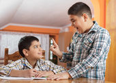 Two schoolboys discussing — Stock Photo