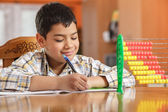 Little boy writing homework — Stockfoto