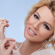 Stock Photo: Beautiful blonde girl with Pearls