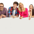 Happy young people with a banner — Stock Photo