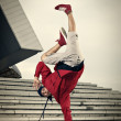 Hip Hop street dancer one hand stand — Stock Photo