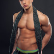 Athletic young guy with scarf around his neck — Stockfoto