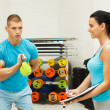 Young man exercises with kettle bell — Stock Photo