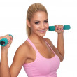 Stock Photo: Beautiful young female exercising with dumbells