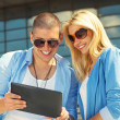 Young couple using tablet PC — Stock Photo