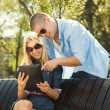 Young modern couple using digital tablet — Stock Photo