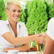 Stock Photo: Two women face to face at business meeting handshaking