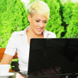 Young businesswoman on coffee break, using laptop — Stock Photo