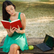 Stock Photo: Woman reading book