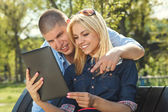 Couple using a digital tablet — Stock Photo