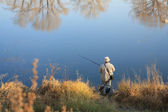The fisherman on a channel of Yenisei — Stock Photo