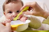 Mother feeding baby — Stock Photo