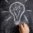 Stock Photo: Lightbulb drawn on blackboard