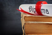 Diploma and books — Stock Photo