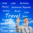 Man writing the names of travel destinations — Stock Photo