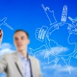 Stock Photo: Young man drawing an imaginary airplane flying