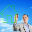 Man drawing a house in the sky — Stock Photo