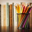 Wire desk tidy full of coloured pencils — Stock Photo #28559687