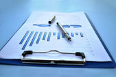 Clipboard with analytical graphs — Stock Photo