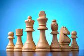 Retro wooden chess pieces — Stock Photo