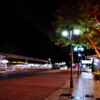 Night view of the street with shops — Stock Photo