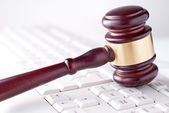 Gavel on a computer keyboard — Stock Photo
