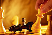 Man going for checkmate in a game of chess — Stock Photo