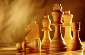 Chess pieces in light wood — Stock Photo