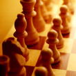 Stock Photo: Chess pieces in yellow ambient light
