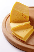 Block of cheese cut into slices — Stock Photo