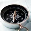Stock Photo: Handheld compass on map