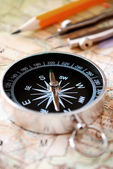 Compass and pencil on a map — Stock Photo