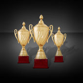 Three gold cups or championship trophies — Stock Photo