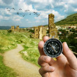 Musing compass while sightseeing abroad — Stock Photo #38640149