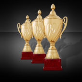 Receding row of gold trophies — Stock Photo