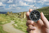 Man using a compass while sightseeing abroad — Stock Photo