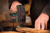 Elderly carpenter working in his workshop — Stock Photo